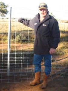 graham-chambers-with-the-exclusion-fence-he-erected-on-his-western-queensland-property